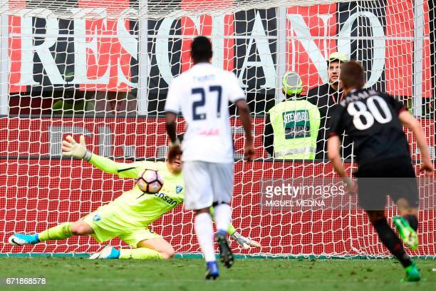Empoli's Poland goalkeeper Lukasz Skorupski stops a penalty during the Italian Serie A football match AC Milan vs Empoli at the San Siro stadium in...