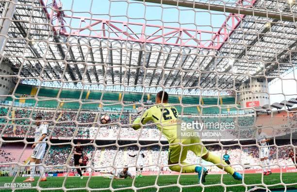 Empoli's Polish goalkeeper Lukasz Skorupski makes a save during the Italian Serie A football match AC Milan vs Empoli at the San Siro stadium in...