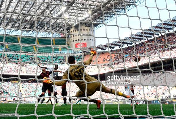 Empoli's Senegalese forward Mame Baba Thiam scores against AC Milan's goalkeeper Gianluigi Donnarumma during the Italian Serie A football match AC...