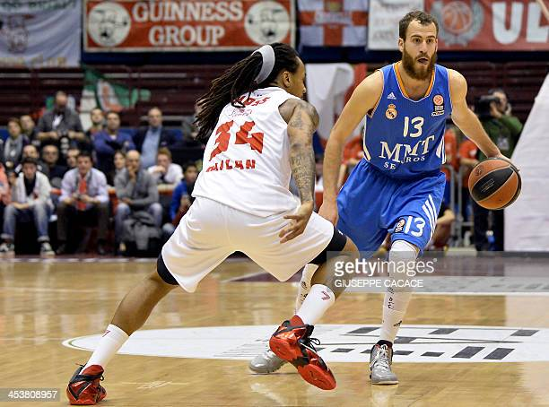 Emporio Armani Milan's US forward David Moss challenges Real Madrid's point guard Sergio Rodriguez during their Euroleague group B basketball match...