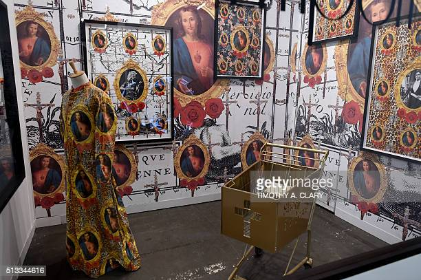 Emporium by Kudzanai Chiurai is viewed during the VIP opening of The Armory Show 2016 in New York March 2 2016 / AFP / Timothy A CLARY / RESTRICTED...