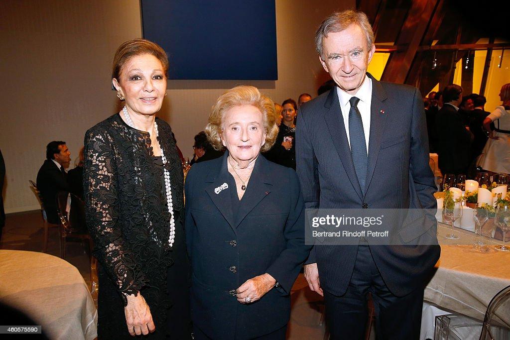 HIH Empress Farah Pahlavi, President of the 'Claude Pompidou Foundation' Bernadette Chirac and Owner of LVMH Luxury Group Bernard Arnault attend the 'Fondation Claude Pompidou' : Charity Party at Fondation Louis Vuitton on December 16, 2014 in Paris, France.