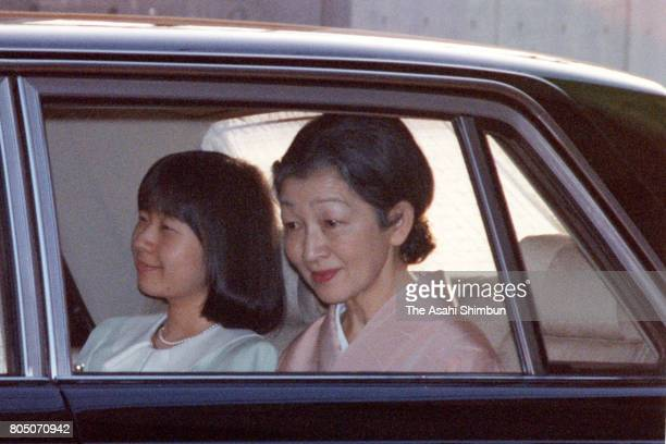 Empress Michiko and Princess Sayako are seen on departure for the New Zealand Embassy on February 17 1994 in Tokyo Japan