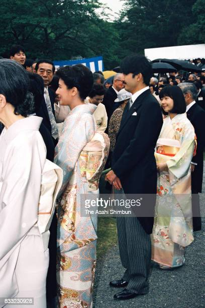 Empress Michiko Crown Princess Masako Prince Akishino and Princess Sayako talk with guests during the Spring Garden Party at the Akasaka Imperial...