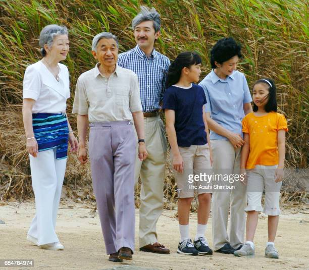 Empress Michiko Emperor Akihito Prince Akishino Princess Mako Princess Kiko and Princess Kako stroll a beach as they visit the Suzaki Imperial Villa...