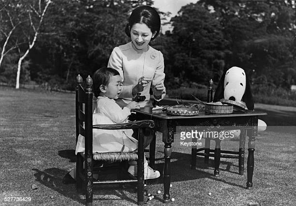 Empress Michiko of Japan with her daughter Sayako Princess Nori in the grounds of the palace in Tokyo Japan around the time of her 36th birthday 26th...