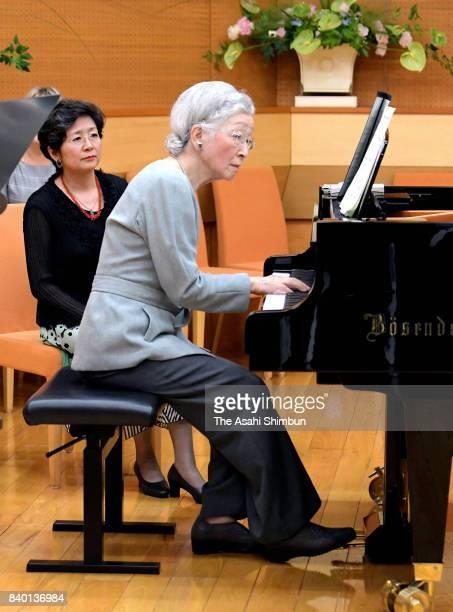 Empress Michiko plays piano during a workshop of the Kusatsu International Summer Music Academy Festival at Kusatsu OngakunoMori International...