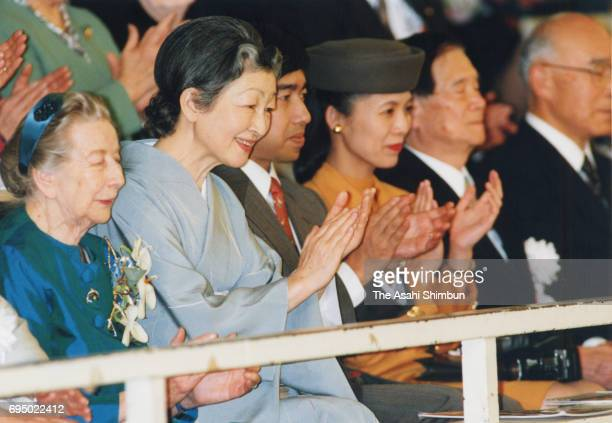 Empress Michiko Prince Takamado and Princess Hisako of Takamado attend a Suzuki Method Grand Concert at Nippon Budokan on March 27 1996 in Tokyo Japan