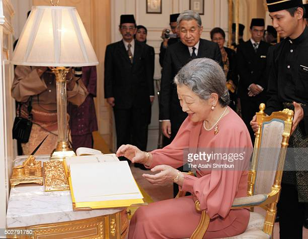 Empress Michiko signs the visitors book prior to the dinner hosted by Malaysian King at Istana Negara on June 10 2006 in Kuala Lumpur Malaysia