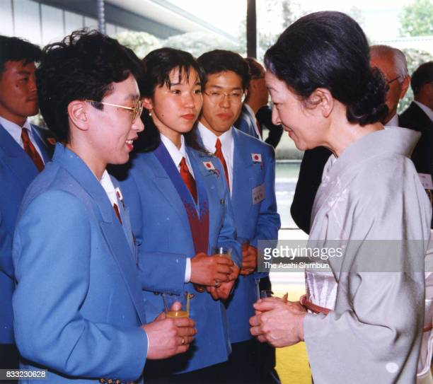 Empress Michiko talks with speed skaters Seiko Hashimoto and Hiromi Yamamoto during the tea party inviting Olympic medalists at the Imperial Palace...