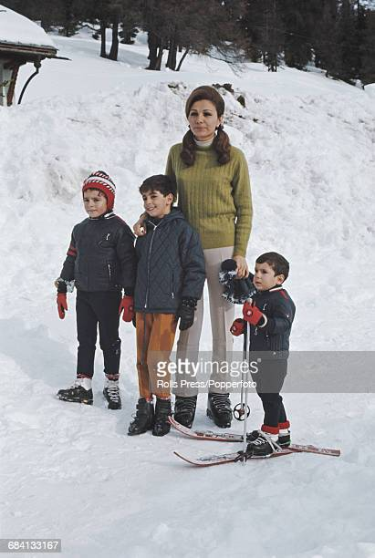 Empress of Iran Farah Diba pictured with her children Reza Pahlavi Farahnaz Pahlavi and AliReza Pahlavi during a skiing holiday at St Moritz in...
