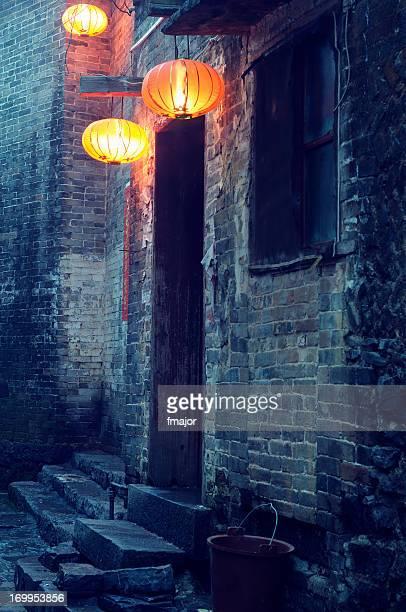 Empty alley with Chinese lanterns around dark doorway