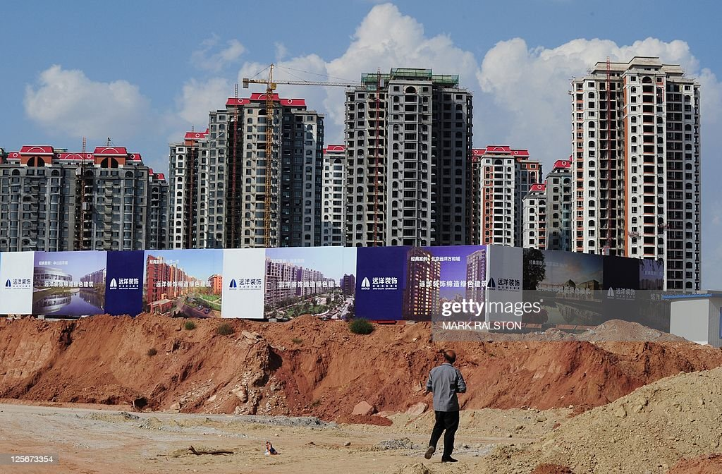 Empty apartment developments stand in the city of Ordos Inner Mongolia on September 12 2011 The city which is commonly referred to as a 'Ghost Town'...