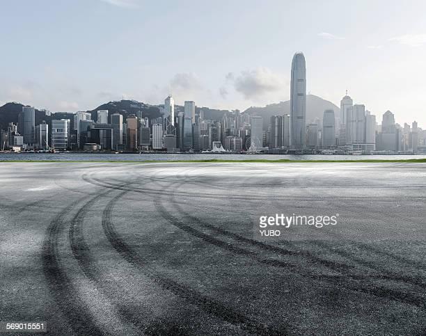 Empty asphalt road and city