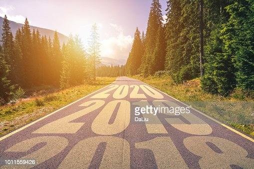 Empty asphalt road and New year 2018, 2019, 2020 concept. Driving on an empty road in the mountains to upcoming 2018, 2019, 2020 and leaving behind old years. Concept for success and passing time. : Stock Photo