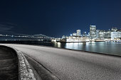 empty asphalt road with cityscape and skyline of san francisco