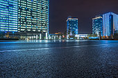 empty asphalt road with cityscape and skyline of Shanghai at night.