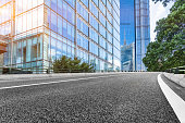 empty asphalt road with cityscape and skyline of Shanghai in China.