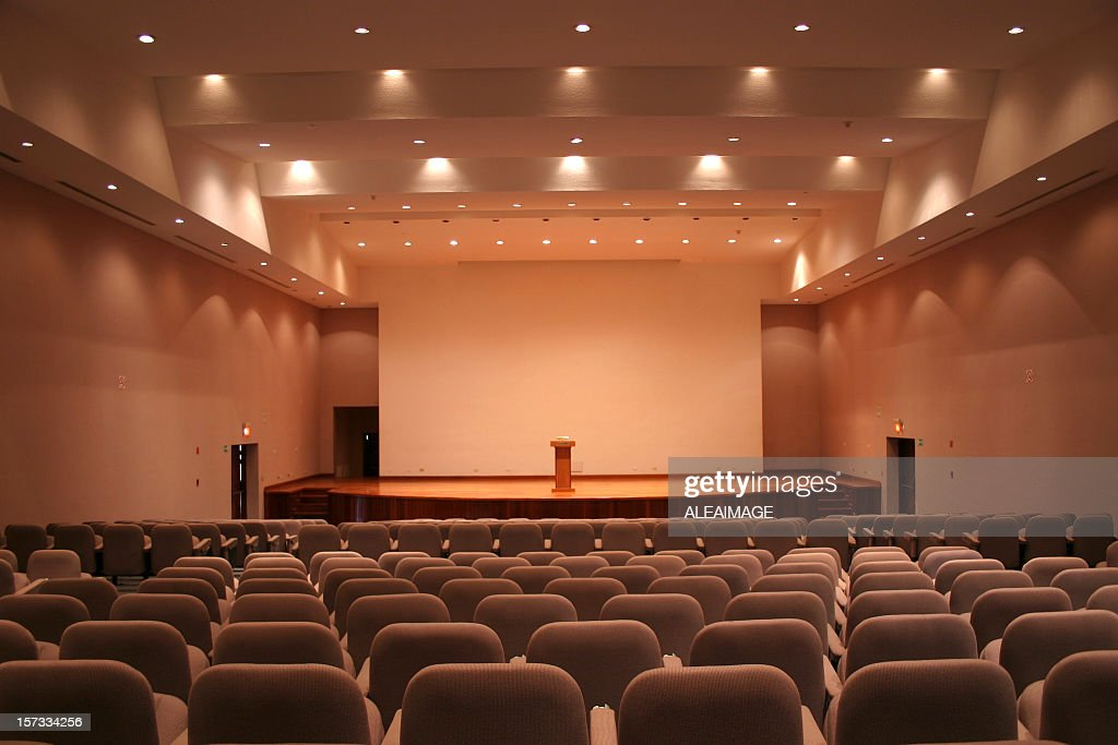 Empty auditorium with grey seats and downlights : Stock Photo
