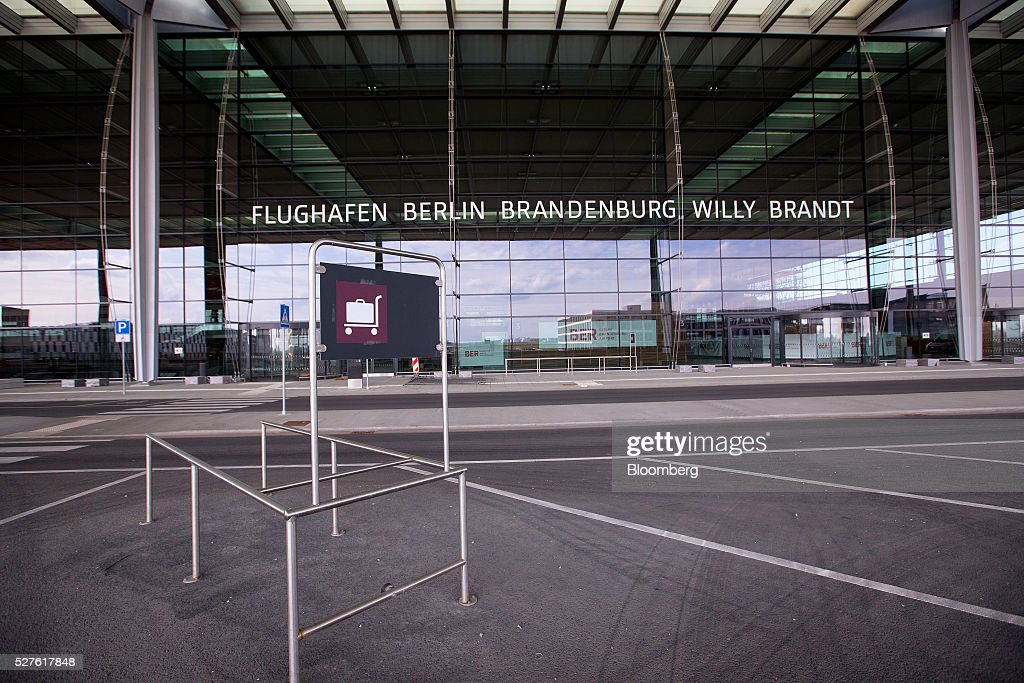 Empty automobile parking spaces sit in a passenger drop off area outside Berlin Brandenburg International Willy Brandt Airport in Schoenefeld, Germany, on Monday, May 3, 2016. The massively overbudget airport was planned to open in 2010 and handle 27 million passengers a year, crowning Berlin as the continent's 21st century crossroads. Photographer: Krisztian Bocsi/Bloomberg via Getty Images