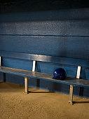 Empty baseball dugout with helmet