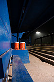 Empty baseball dugout with water coolers