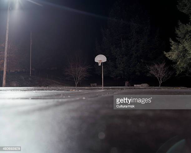 Empty basketball court at night
