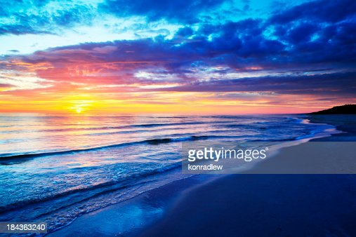 Empty Beach and Ocean during Sunset