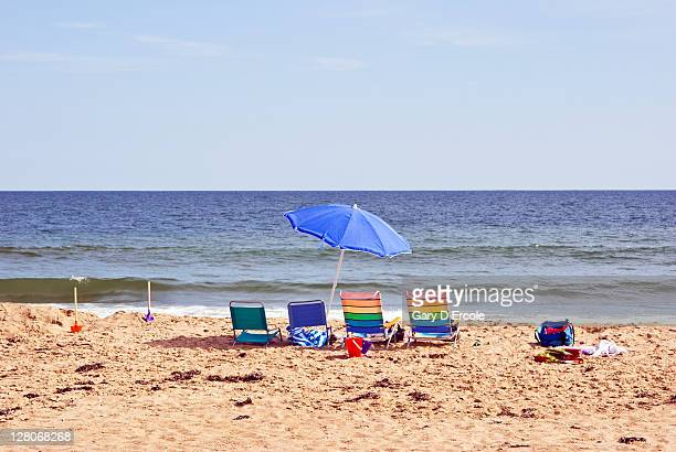 Empty beach chairs, pales, shovels and umbrella on beach on Martha's Vineyard, Massachusetts, USA, August 2010