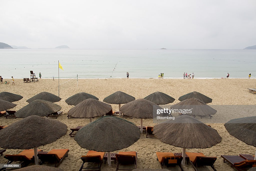 Empty beach chairs stand on the beach in the Yalong Bay district of Sanya, Hainan, China, on Sunday, April 6, 2014. Chinas broadest measure of new credit fell 19 percent from a year earlier and money supply grew at the slowest pace since 2001, underscoring risks of a deeper slowdown as the government tries to curb financial dangers. Photographer: Brent Lewin/Bloomberg via Getty Images