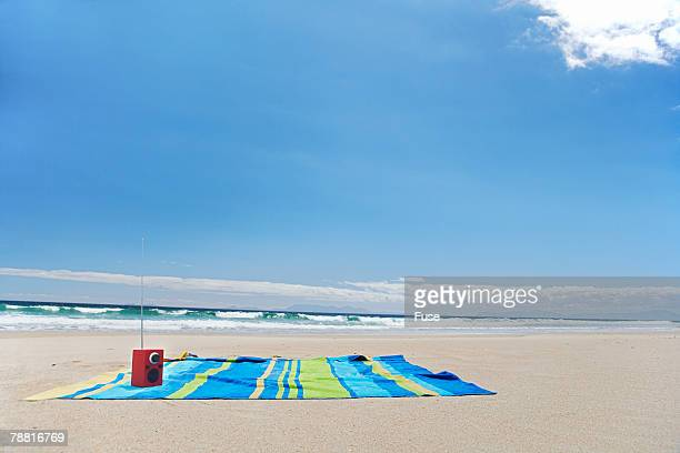 Empty Beach Towel by Ocean