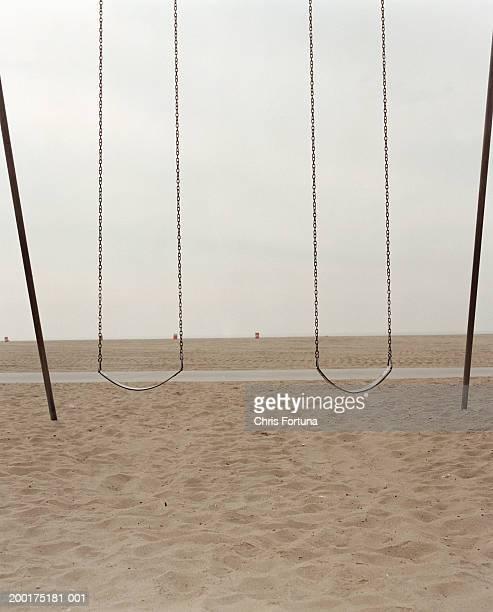 Empty beach with swings