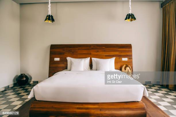Empty bed in modern hotel room