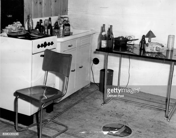 Empty beer bottles and glasses littered the apartment of Fred M Freeman which was raided by morals bureau officers Friday night Sixteen persons...
