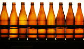 Empty beer bottles are seen in a filling station at the Maisacher brewery on April 22 2008 in Maisach near Munich Germany Beer is regarded as the...
