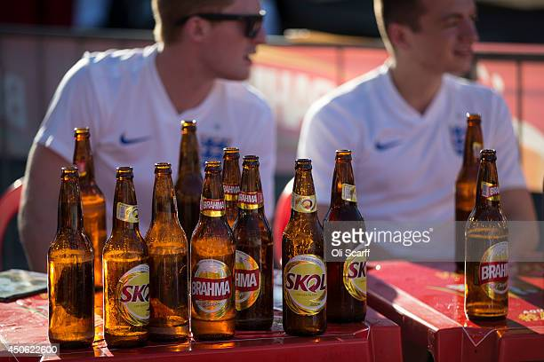 Empty beer bottles are stacked on a table of England football fans as they watch the game between Uruguay and Costa Rica in the FIFA World Cup on...