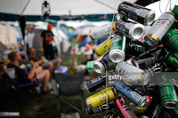 Empty beer cans are pictured at a campsite during the 24th heavy metal Wacken Open Air Festival 2013 in Wacken northern Germany walk next to a fence...