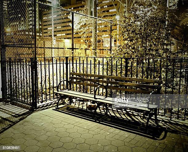 Empty bench at night, Brooklyn, New York, USA
