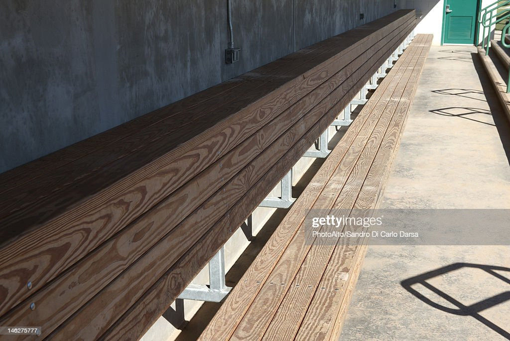 Empty bench in baseball dugout