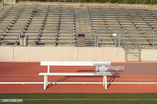 Empty bench on sidelines of field