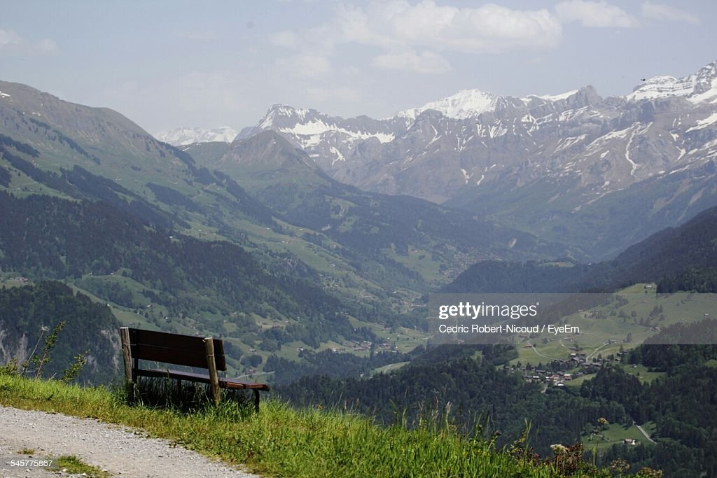 Empty Bench Overlooking Scenic Landscape