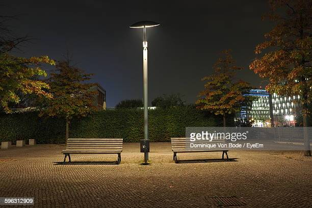 Empty Benches Under Street Light