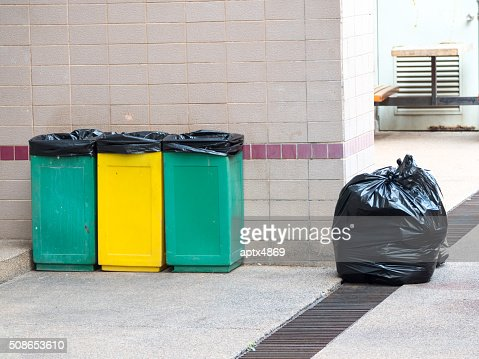 empty bins and black garbage bags : Stock Photo