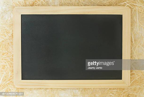Empty blackboard on hay