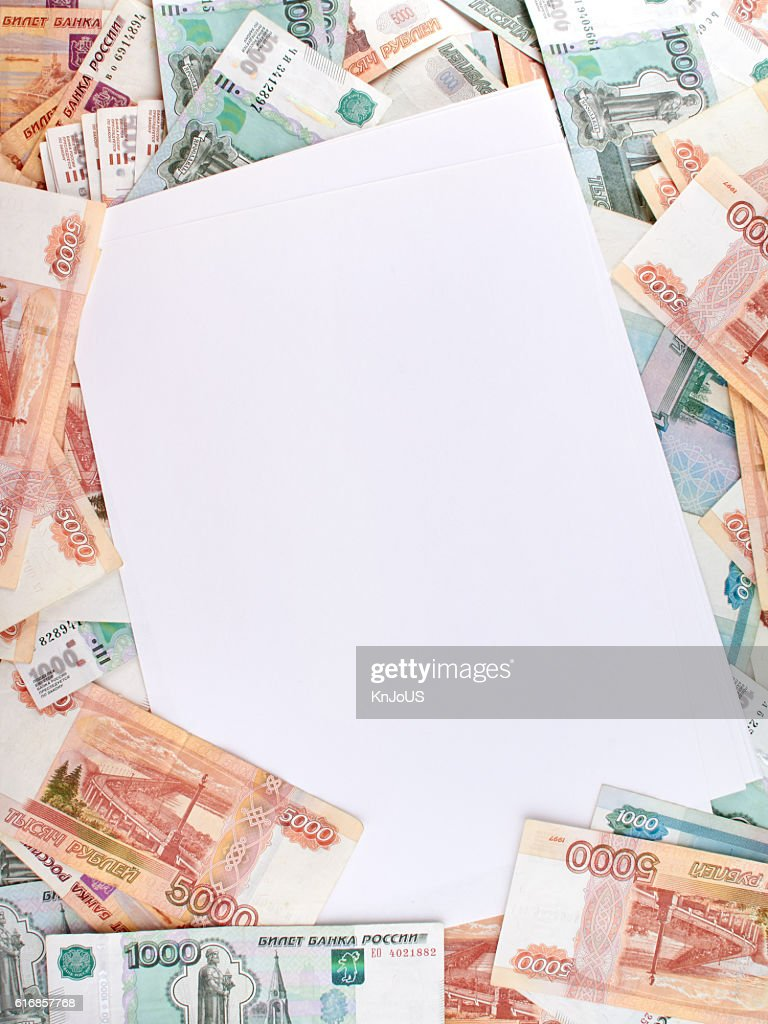 Empty blank on the background a large number of rubles. : Stock Photo