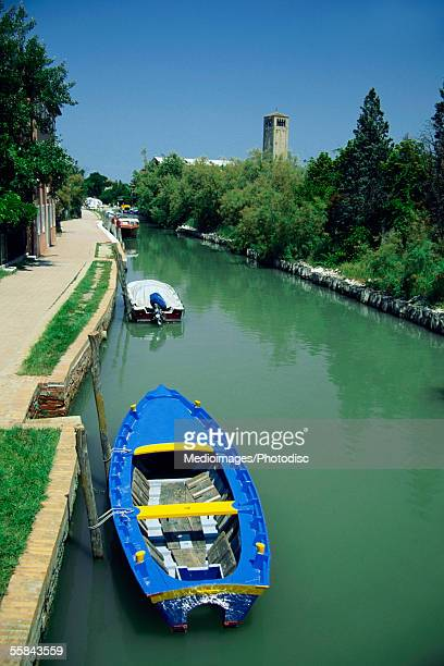 Empty blue motorboat in a canal, Torcello, Italy