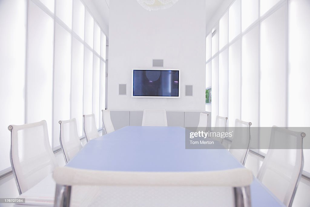 Empty boardroom with large television hanging on wall : Stock Photo