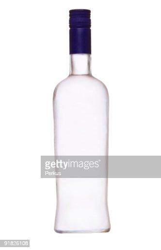 Empty bottle of vodka with a blue cap