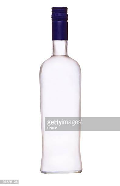 Empty bottle of vodka with a blue cap
