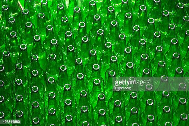 Empty bottles for Heineken beer move along the production line at the Heineken NV brewery in Saint Petersburg Russia on Wednesday Nov 18 2015...